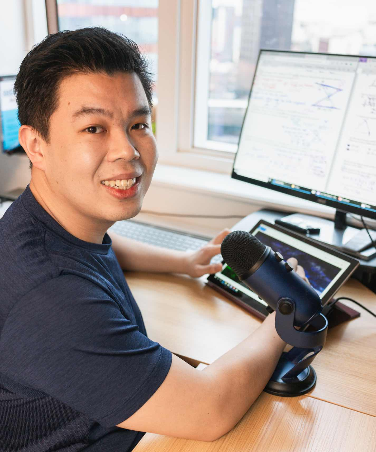 Picture of Akira Wong at a computer